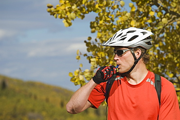 Man wearing bicycle helmet, Utah, United States