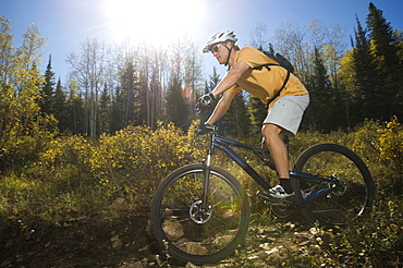 Man riding mountain bike, Utah, United States
