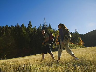 Couple hiking with backpacks, Utah, United States
