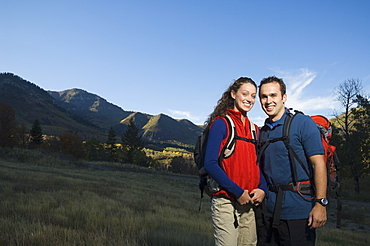 Couple wearing backpacks outdoors, Utah, United States