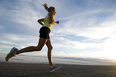 Woman running on road, Utah, United States