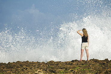 Woman looking out over ocean, Oahu, Hawaii, United States