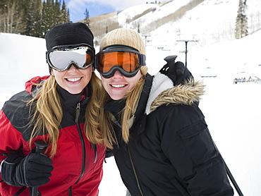 Woman in ski gear hugging