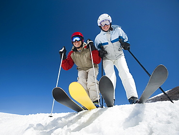 Couple standing on skis
