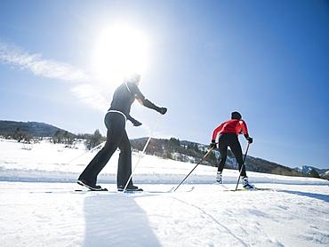 Couple cross country skiing