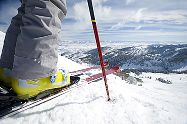 Close up of skier at top of mountain