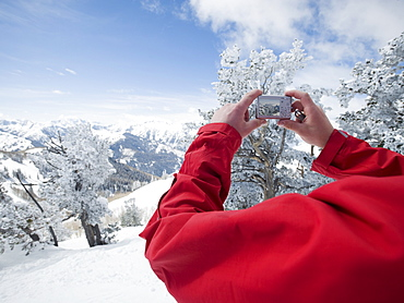 Man taking photograph, Wasatch Mountains, Utah, United States