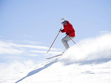 Man skiing downhill