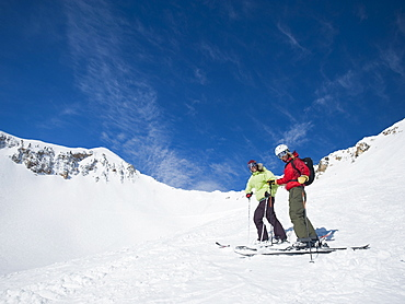 Women standing on skis