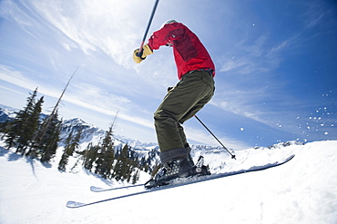 Woman on skis in air