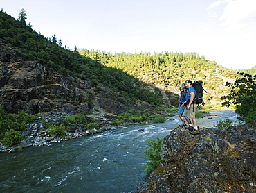 Hikers admiring view of river