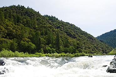 Whitewater raft approaching waterfall