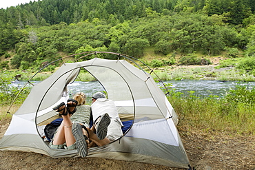 Couple relaxing in tent