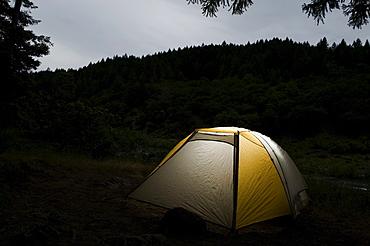 Tent illuminated at night