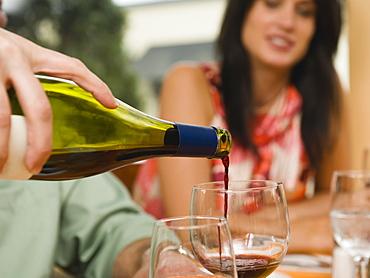 Waiter pouring wine in restaurant