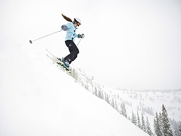 A downhill skier jumping