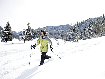 A woman snow shoeing