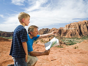 A father and son at Red Rock with a map