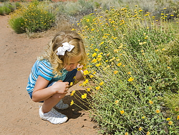A young girl by wildflowers in Red Rock