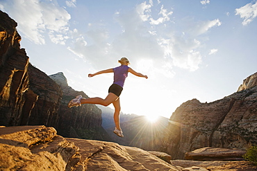 A woman jumping on rock at Red Rock