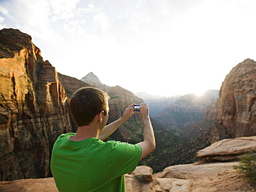 A man taking a picture at Red Rock