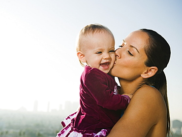 Woman kissing toddler