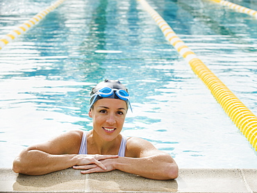 Woman resting after swimming laps