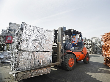 Forklift driver at recycling plant