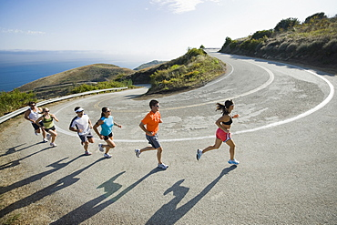 Runners on a road in Malibu