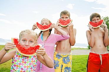 Kids (6-7,8-9,10-11,12-13) eating watermelon