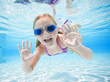 Girl (6-7) swimming underwater