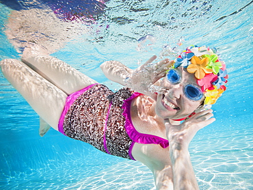 Girl (8-9) swimming underwater
