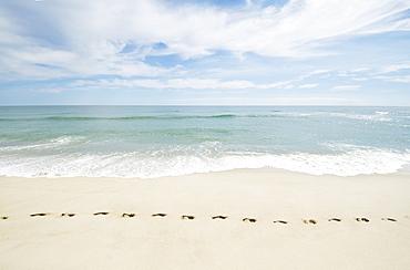 Footprints on empty beach