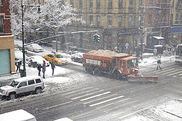 Snowplow on street, New York City