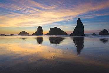 Beach with stack rocks at sunset, Bandon, Oregon