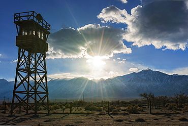 View at Manzanar Historic Site with silhouette of watchtower, USA, California, Manzanar Historic Site