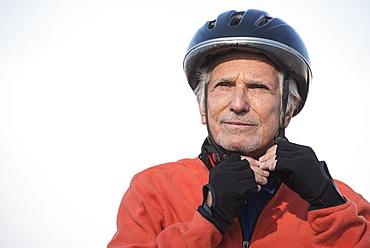 Close up of senior man in biking helmet