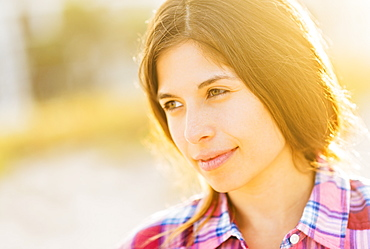Portrait of young woman in sunlight