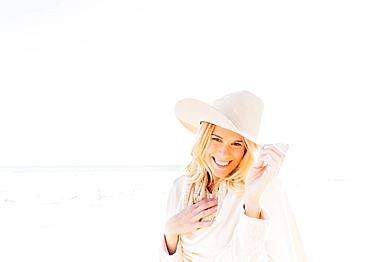 Portrait of woman in cowboy hat on beach, Jupiter, Florida