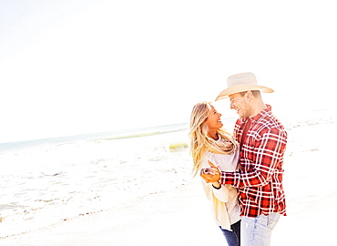 Smiling couple dancing on beach, Jupiter, Florida