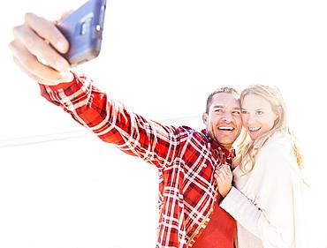 Couple taking selfie on beach