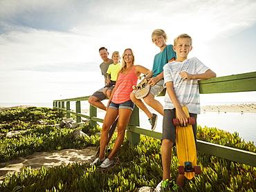 Portrait of family with three children (6-7, 10-11, 14-15) on vacation, Laguna Beach, California