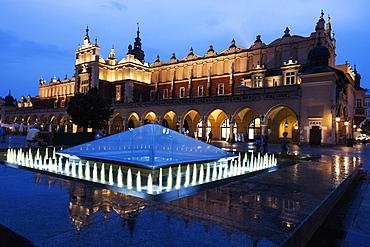 Fountain and Cloth Hall evening time, Krakow, Poland