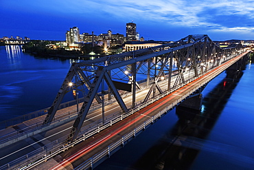 Alexandra Bridge and river bank at dusk, Quebec, Canada