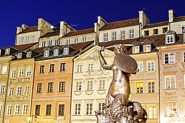 Mermaid of Warsaw against buildings, Poland