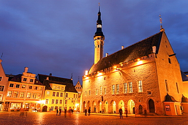 Illuminated Town Hall seen from across square at dusk, Tallin, Estonia