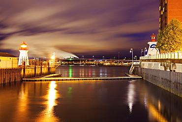 Illuminated Saint John Coast Guard Base Lighthouse seen from harbor, New Brunswick, Canada