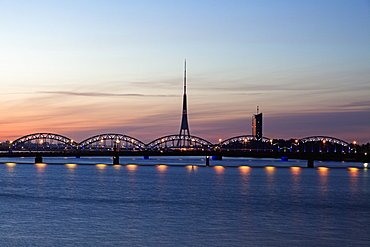 Arch bridge and Riga Radio and TV Tower at sunrise, Latvia