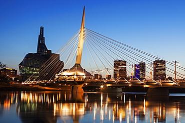 Canadian Museum for Human Rights and Esplanade Riel bridge at dusk, Winnipeg Manitoba, Canada