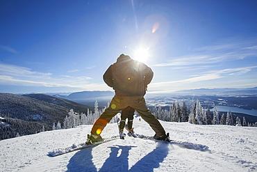 Father skiing with son (6-7), Whitefish, Montana USA
